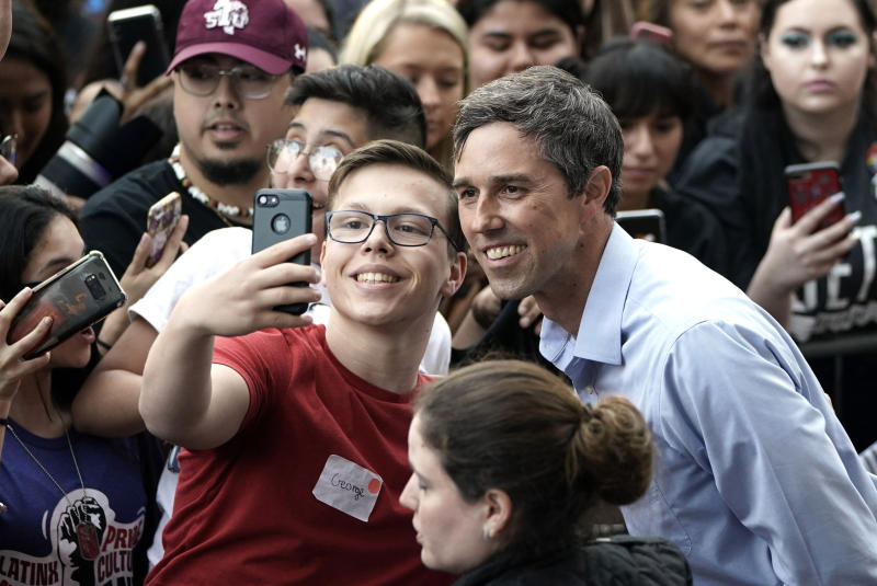 Democratic presidential candidate and former Texas congressman Beto O'Rourke, right, poses for a photograph with a supporter during his presidential campaign kickoff rally in Houston, Saturday, March 30, 2019. (AP Photo/David J. Phillip)