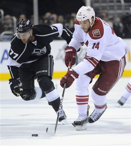 Phoenix Coyotes left wing Taylor Pyatt, right, skates past Los Angeles Kings center Jeff Carter during the first period of Game 3 of the NHL hockey Stanley Cup Western Conference finals, Thursday, May 17, 2012, in Los Angeles. (AP Photo/Mark J. Terrill)