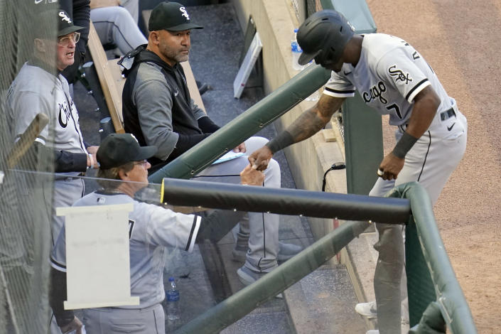 Chicago White Sox's Tim Anderson, right, is congratulated in the dugout by manager Tony La Russa after he scored on a double by Nick Madrigal off Minnesota Twins' pitcher J.A. Happ in the fourth inning of a baseball game, Monday, May 17, 2021, in Minneapolis. (AP Photo/Jim Mone)