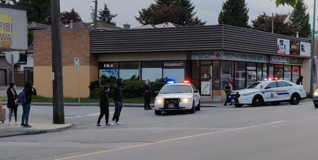 Police in Burnaby respond to a shooting at 12th Avenue and 6th Street on May 8, 2021. (Justin Correia - image credit)