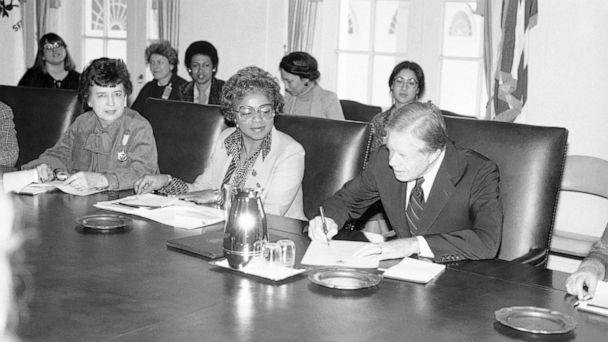 PHOTO: President Jimmy Carter signs document proclaiming March 2-8 'National Women's History Week' at the White House, Feb. 28, 1980.  (Barry Thumma/AP, FILE)