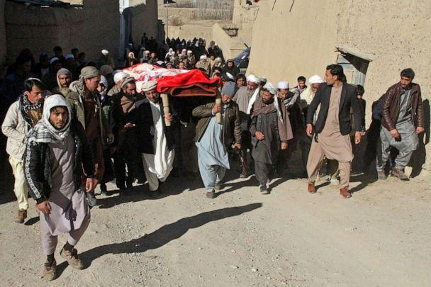 PHOTO: Family members and relatives take part in the funeral procession of Afghan journalist Rahmatullah Nekzad at Khoja Omari in Ghazni, Afghanistan, Dec. 22, 2020. (AFP via Getty Images)