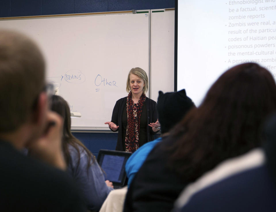 """In a photo provided by Central Michigan Univserity, Kelly Murphy, a philosophy and religion faculty member at Central Michigan University, teaches a religion course titled """"From Revelation to'The Walking Dead'"""" Thursday, Jan. 23, 2014, in Mount Pleasant, Mich. The course explores biblical texts and apocalyptic themes in media. (AP Photo/Christina Kurtz)"""