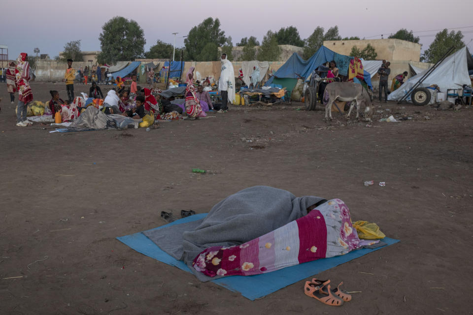 Tigray refugees who fled the conflict in the Ethiopia's Tigray take shelter at Hamdeyat Transition Center near the Sudan-Ethiopia border, eastern Sudan, Thursday, Dec. 3, 2020. Ethiopian forces on Thursday blocked people from the country's embattled Tigray region from crossing into Sudan at the busiest crossing point for refugees, Sudanese forces said.(AP Photo/Nariman El-Mofty)