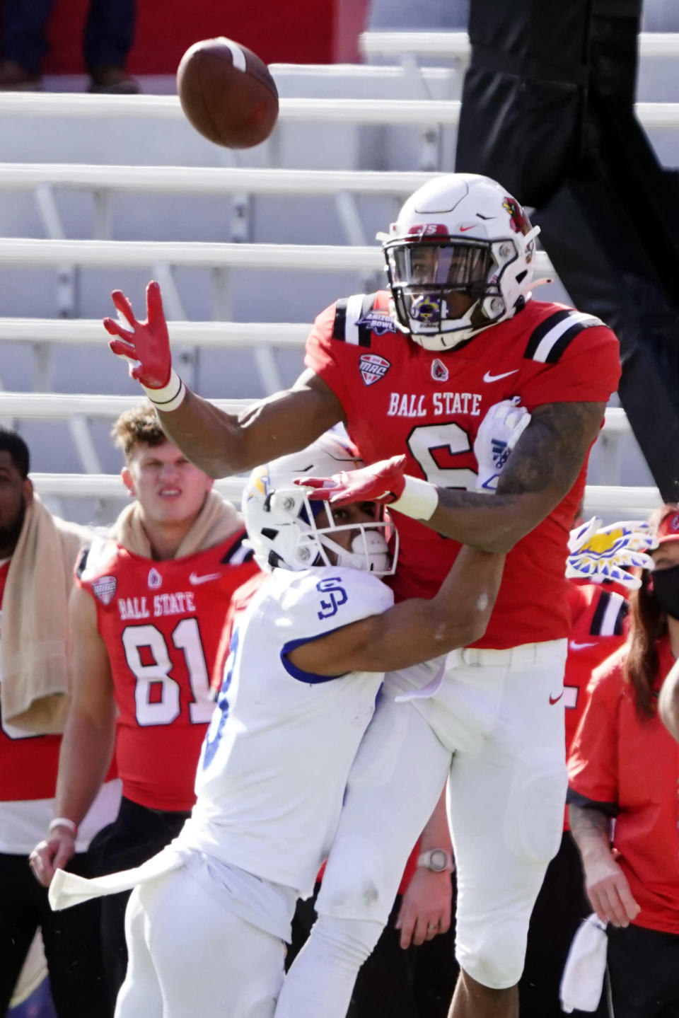 Ball State wide receiver Yo'Heinz Tyler (6) makes a catch in front of San Jose State linebacker Alii Matauin the first half of the Arizona Bowl NCAA college football game, Thursday, Dec. 31, 2020, in Tucson, Ariz. (AP Photo/Rick Scuteri)