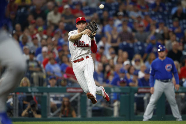 Philadelphia Phillies third baseman Scott Kingery throws to first after fielding a ground out by Chicago Cubs' Jose Quintana during the third inning of a baseball game, Tuesday, Aug. 13, 2019, in Philadelphia. (AP Photo/Matt Slocum)