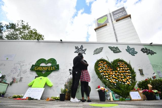 People at the Grenfell Memorial Community Mosaic (Victoria Jones/PA)