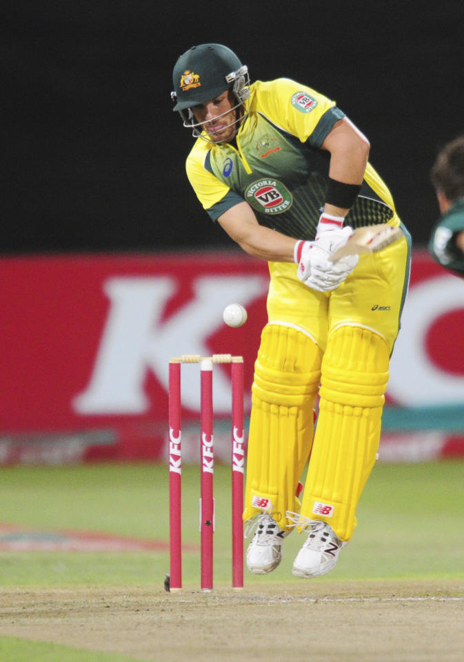 In this photo taken Wednesday, March 12, 2014, Australia's Aaron Finch is at the wicket during their rain-delayed T20 cricket match against South Africa in Durban, South Africa. (AP Photo)