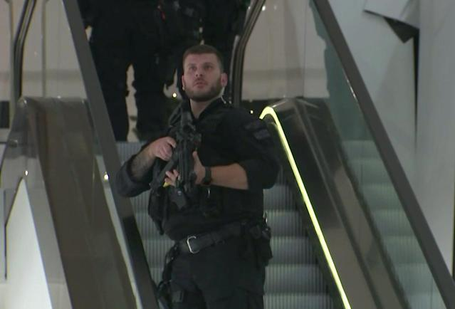 <p>In this grab taken from video, an armed police office patrols a department store, near to Oxford Street, in London, Friday, Nov. 24, 2017. (Photo: AP) </p>