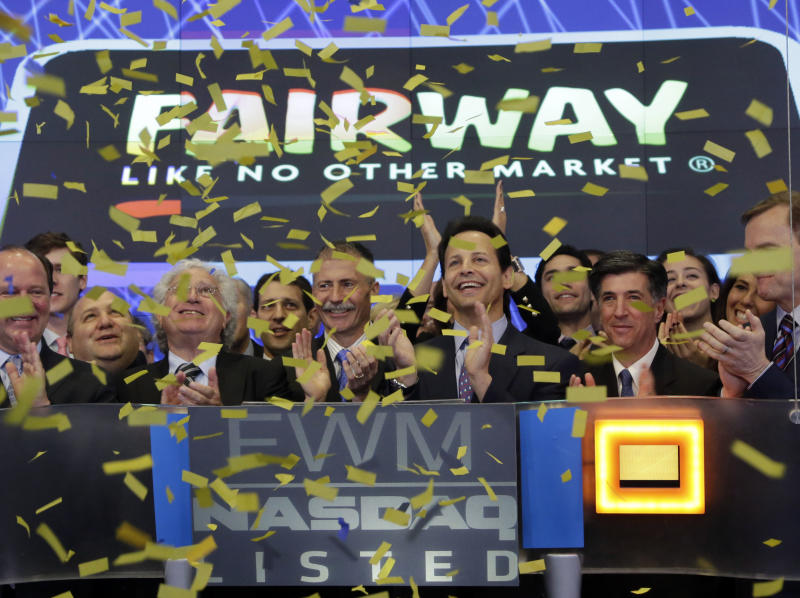 Fairway Chairman Charles Santoro, third from right, and CEO Herb Ruetsch, center, join in the applause during their company's IPO at the Nasdaq MarketSite, in New York's Times Square,  Wednesday, April 17, 2013. Fairway, a grocery store chain, is well-known among New York shoppers for offering relatively lower prices and cramming its shelves with a wide assortment. The company has 12 locations in the region, including in Connecticut and New Jersey. (AP Photo/Richard Drew)