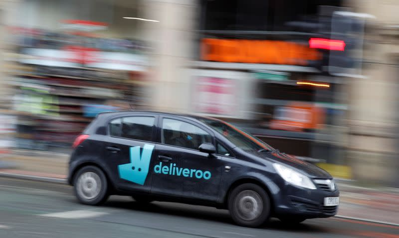 A deliveroo delivery driver is seen in the centre of Manchester