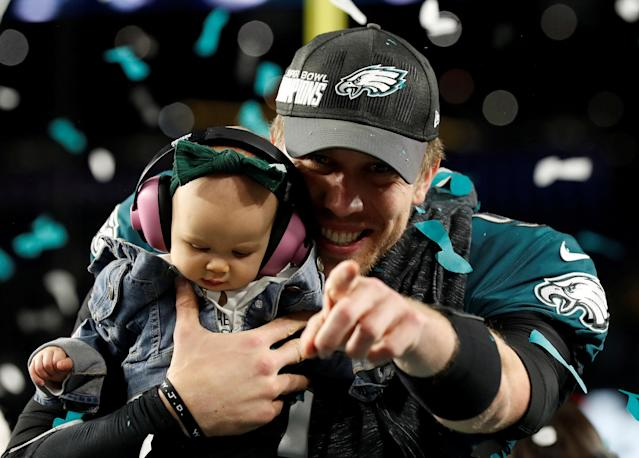 NFL Football - Philadelphia Eagles v New England Patriots - Super Bowl LII - U.S. Bank Stadium, Minneapolis, Minnesota, U.S. - February 4, 2018 Philadelphia Eagles' Nick Foles celebrates with his daughter after winning Super Bowl LII REUTERS/Kevin Lamarque TPX IMAGES OF THE DAY