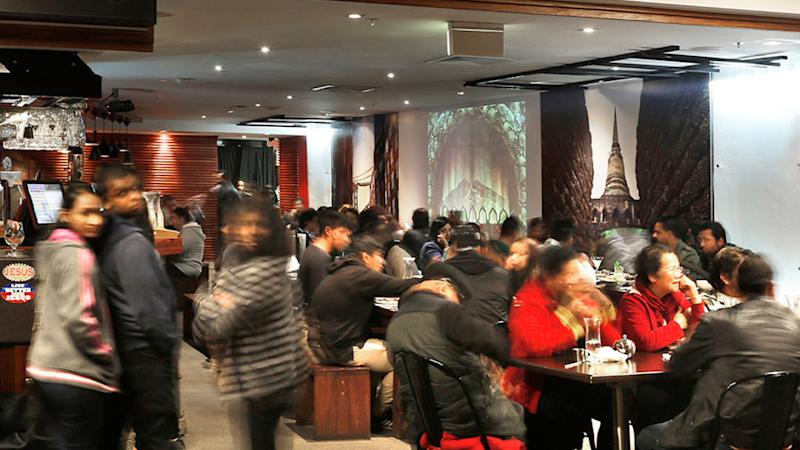 Stock image of diners at Thai Rock restaurant.