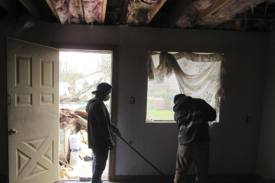 Construction workers continue Friday, January 31, 2020, repairing and cleaning up the Hurricane Harvey damaged home of Houston resident Lawrence Hester. Hester said he was unable to get help from a city program created to fix homes damaged during Harvey and had to endure hazardous living conditions for more than two years. He turned to a local nonprofit to fix his home. The city program has finished rebuilding less than 70 homes since beginning in January 2019. (AP Photo/Juan Lozano)