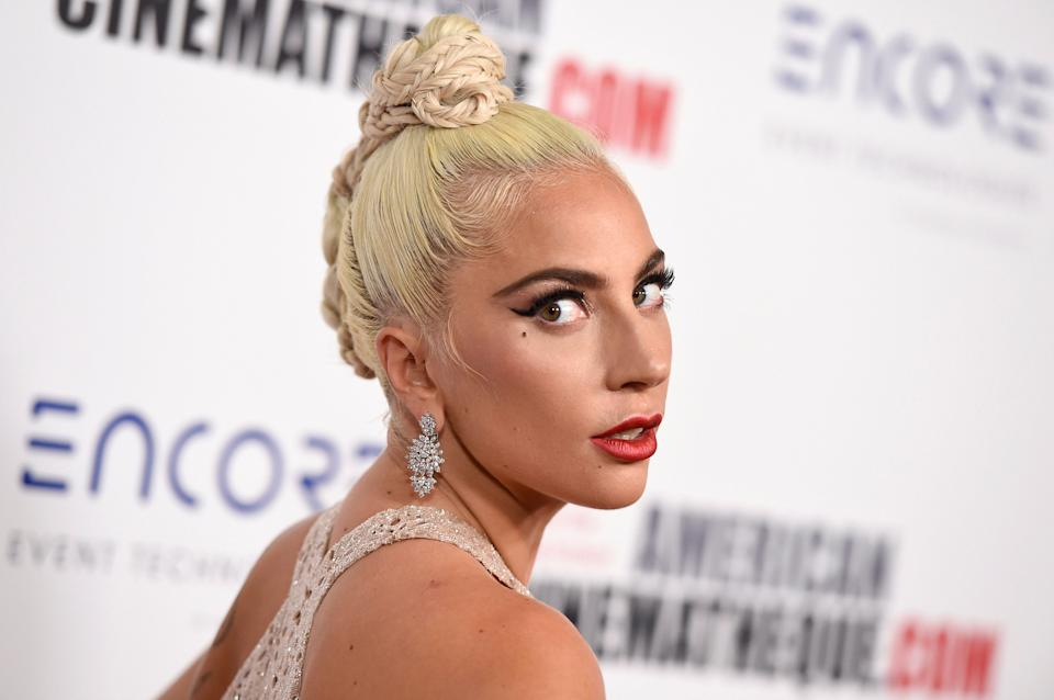 """Lady Gaga arrives at the American Cinematheque Award ceremony, Nov. 29in Beverly Hills, California. In """"A Star Is Born,"""" her character's record deal comes with a choreographer, backup dancers and a new look. (Photo: Jordan Strauss/Invision/AP)"""