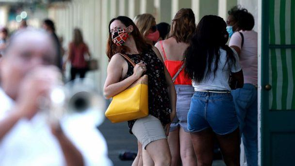 PHOTO: A woman waits in line for carryout at Cafe Du Monde in the French Quarter on July 14, 2020 in New Orleans. (Sean Gardner/Getty Images)