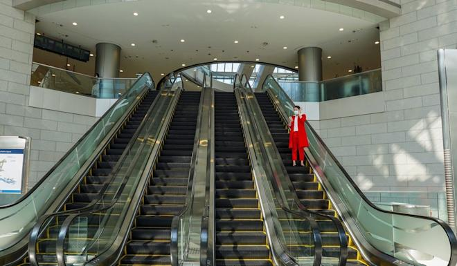 A lone figure at IFC mall in Central. Photo: Robert Ng