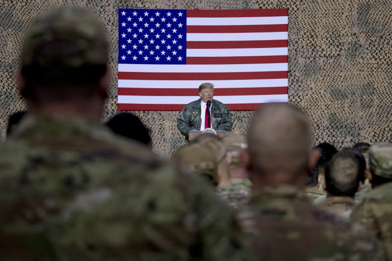 President Donald Trump speaks to members of the military at a hangar rally at Ain al-Asad air base in December. Source: AAP