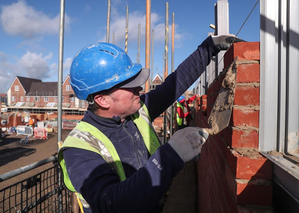 A bricklayer working for Taylor Wimpey builds a wall on an estate in Aylesbury, Britain February 7, 2017.  REUTERS/Eddie Keogh
