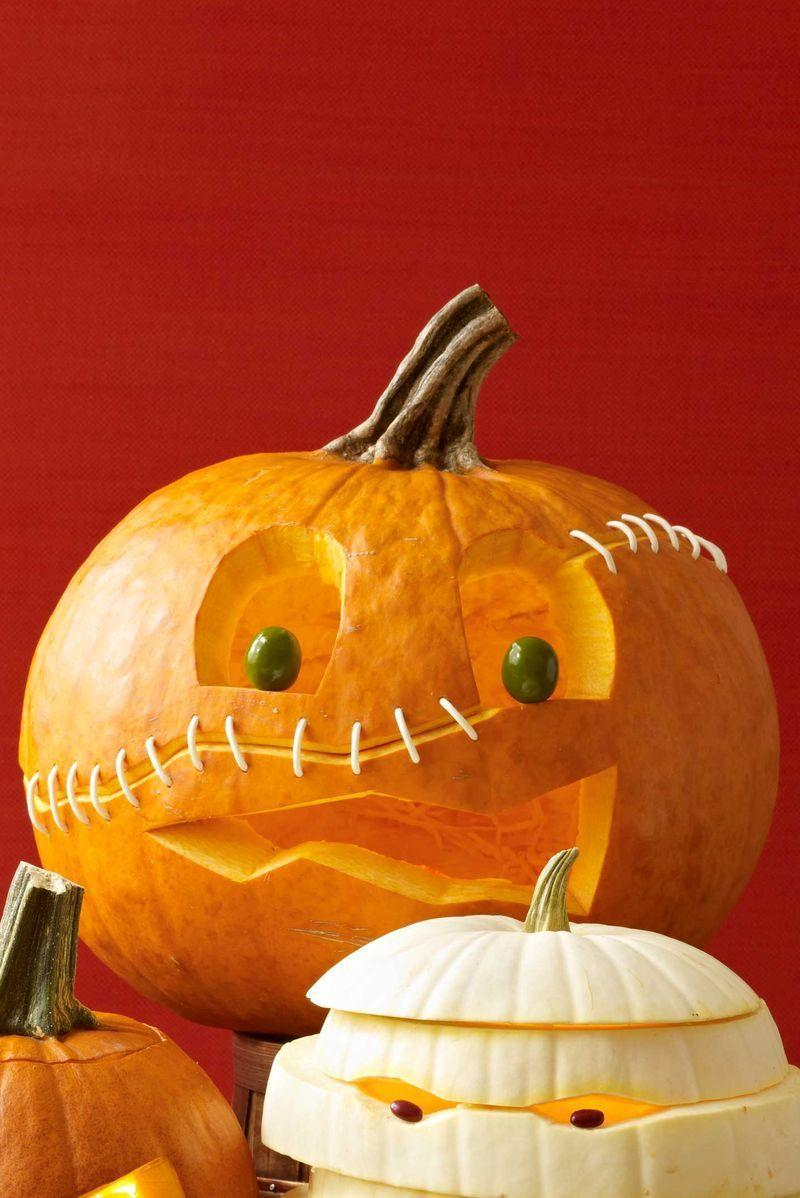 """<p>Draw eyes, mouth and scar (an angled horizontal line that goes all the way around) on the pumpkin with a marker. Following the scar line, cut the pumpkin in half. Scoop out the seeds; discard. Insert many half-toothpicks into the bottom part of the rind; replace the top part, pressing into the exposed toothpicks to hold the parts together.</p><p>Carve out the eyes and mouth; slice into the scar shape at an angle to make it more visible. Wipe off remaining marker with a damp cloth. Using a skewer or awl, puncture pairs of holes opposite each other ½"""" apart along the length of the scar. Bend a <span class=""""redactor-unlink"""">Q-tip</span> into a U shape; press each end into a pair of holes opposite each other. Continue until holes are filled. Press olives onto half-toothpicks and press into eye holes.</p>"""