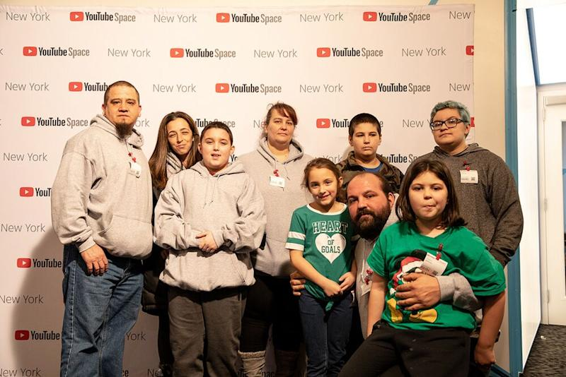Shawny Smith with his family and friends, including mom Monica Velozo, who stands behind him | YouTube Spaces
