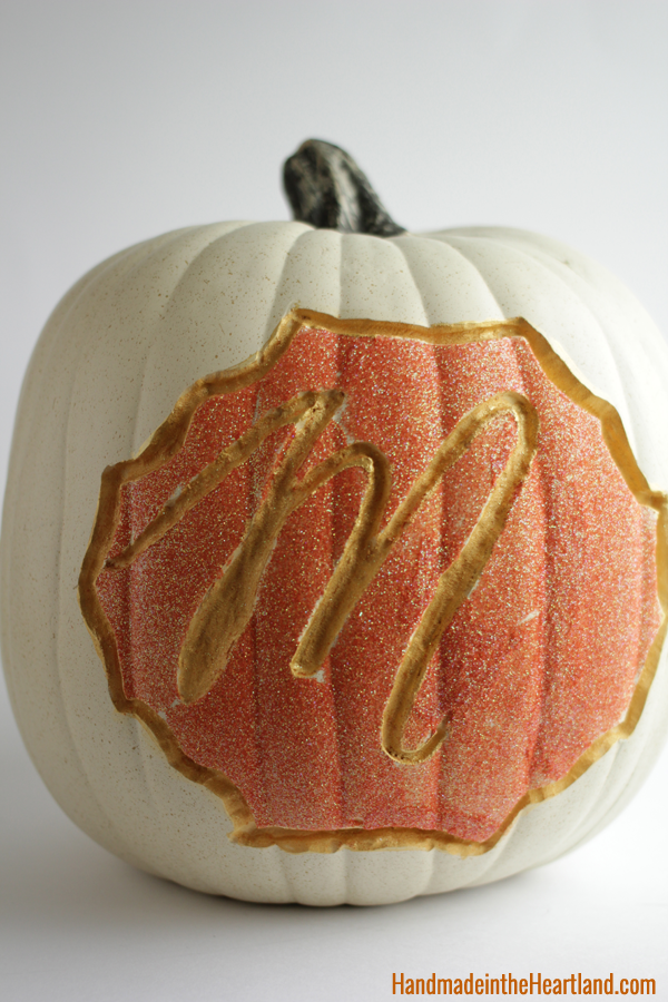 """<p>For a personalized pumpkin, carve your initial into the gourd and fill it in with contrasting paint colors — and sparkles, of course. </p><p><em><a href=""""http://www.handmadeintheheartland.com/2014/10/carved-glittered-painted-funkin.html"""" rel=""""nofollow noopener"""" target=""""_blank"""" data-ylk=""""slk:Get the tutorial at Handmade in the Heartland »"""" class=""""link rapid-noclick-resp"""">Get the tutorial at Handmade in the Heartland »</a></em></p>"""