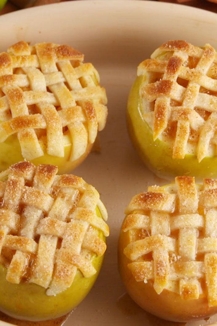 """<p>These apple pies are the cutest things you'll see all fall.</p><p>Get the recipe from <a href=""""https://www.delish.com/cooking/recipe-ideas/recipes/a55164/apple-pie-baked-apples-recipe/"""" rel=""""nofollow noopener"""" target=""""_blank"""" data-ylk=""""slk:Delish"""" class=""""link rapid-noclick-resp"""">Delish</a>.</p>"""