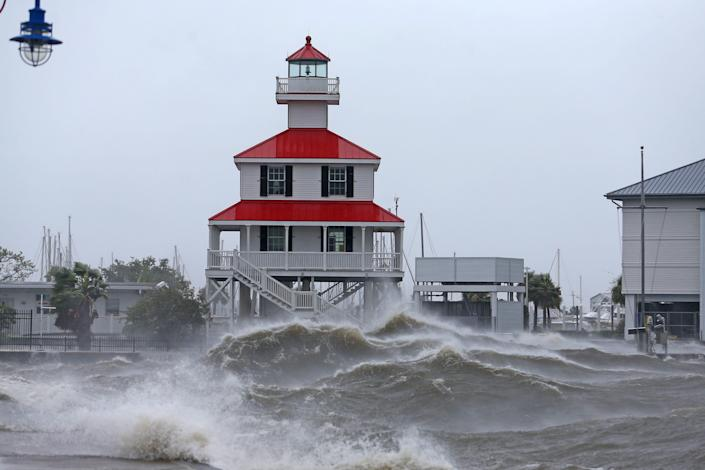Waves crash against the New Canal Lighthouse on Lake Pontchartrain as the effects of Hurricane Ida begin to be felt in New Orleans, Louisiana, U.S., August 29, 2021