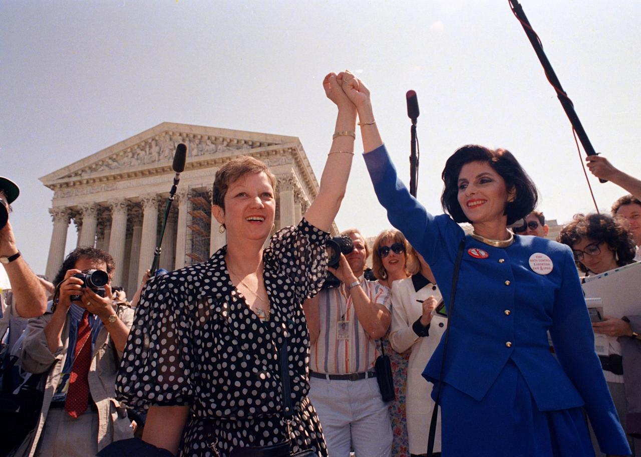 <p> FILE - In this April 26, 1989 file photo, Norma McCorvey, Jane Roe in the 1973 court case, left, and her attorney Gloria Allred hold hands as they leave the Supreme Court building in Washington after sitting in while the court listened to arguments in a Missouri abortion case. McCorvey died at an assisted living center in Katy, Texas on Saturday, Feb. 18, 2017, said journalist Joshua Prager, who is working on a book about McCorvey and was with her and her family when she died. He said she died of heart failure.(AP Photo/J. Scott Applewhite, File) </p>