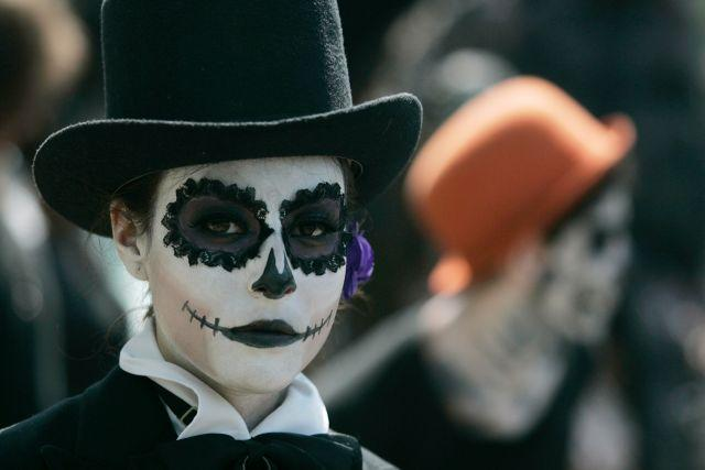"A fine arts student wears make-up during the Catrina's parade in Guadalajara October 26, 2012. Students of fine arts took part in their Catrina's parade as part of the celebrations for the Day of the Dead, local media reported. La Catrina, a popular figure in Mexico known as ""The Elegant Skull""."
