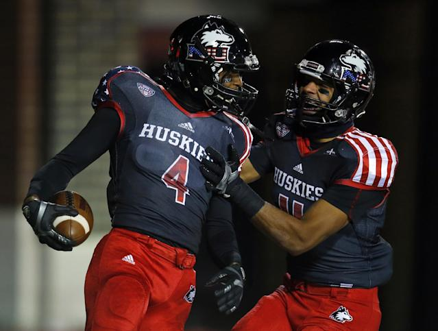 Northern Illinois wide receiver Da'Ron Brown (4) celebrates with Juwan Brescacin (11) after a touchdown reception against Ball State during the first half of an NCAA college football game Wednesday, Nov. 13, 2013, in DeKalb, Ill. (AP Photo/Jeff Haynes)
