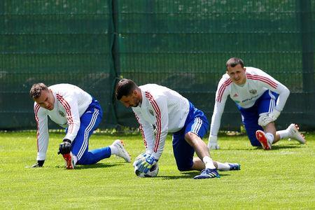 Soccer Football - FIFA World Cup - Russia Training - Neustift, Austria - May 21, 2018 Russia's Igor Akinfeev, Soslan Dzhanaev and Andrey Lunev during training REUTERS/Leonhard Foeger