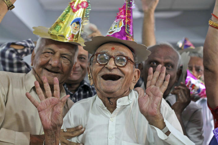 FILE - In this Tuesday, Oct. 1, 2013, file photo, residents of an old age home participate in celebrations to mark International Day of Older Persons in Ahmadabad, India. A handful of countries, such as China, India, France and Ukraine, require adult children to financially support their parents. Similar laws are in place in 29 U.S. states, Puerto Rico and most of Canada, but they are rarely enforced because government aid helps support the old. In Singapore, adult children who do not give their parents an allowance can face six months in jail. (AP Photo/Ajit Solanki, File)