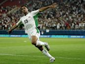 ATHENS - AUGUST 15: Karim Mahdi of Iraq celebrates scoring Iraq's second goal during the men's football preliminary match on August 15, 2004 during the Athens 2004 Summer Olympic Games at Karaiskaki Stadium in Athens, Greece. Iraq defeated Costa Rica 2-0. (Photo by Nick Laham/Getty Images)