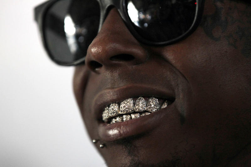 Recording artist Lil Wayne talks during an interview at the opening of a new skateboard park he helped finance along with Glu Agency and Mountain Dew, in the Lower Ninth Ward of New Orleans, Wednesday, Sept. 26, 2012. (AP Photo/Gerald Herbert)