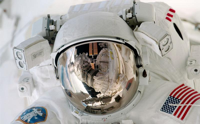 Close views of Paul Richards during an Extravehicular Activity (EVA) on the International Space Station (ISS). View STS102-346-021 is a crew pick selection.