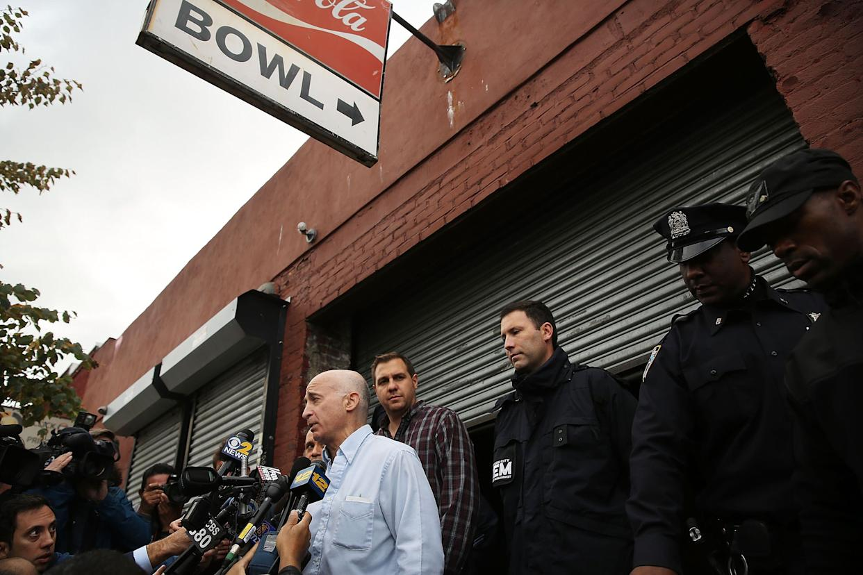 Don Weiss, from the NYC Department of Health and Mental Hygiene, speaks to the media in front of the closed Brooklyn bowling alley that New York City's first Ebola patient visited before showing symptoms of the virus.