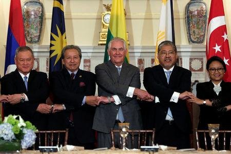 U.S. Secretary of State Rex Tillerson (C) poses with ASEAN foreign ministers before a working lunch at the State Department in Washington, U.S., May 4, 2017. REUTERS/Yuri Gripas