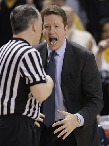 Richmond coach Chris Mooney disputes a call during the first half of an NCAA college basketball game against Virginia Commonwealth in Richmond, Va., Wednesday, March 6, 2013. (AP Photo/Steve Helber)
