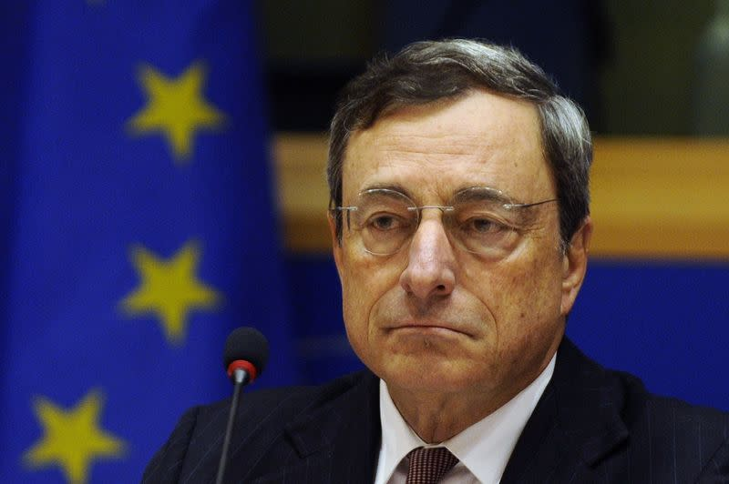 ECB President Draghi waits to take the flloor during the Quarterly Hearing before the Committee on Economic and Monetary Affairs of the European Parliament in Brussels