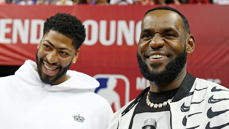 new product 5f906 f4ee8 LeBron James presents Lakers' number 23 jersey to Anthony Davis