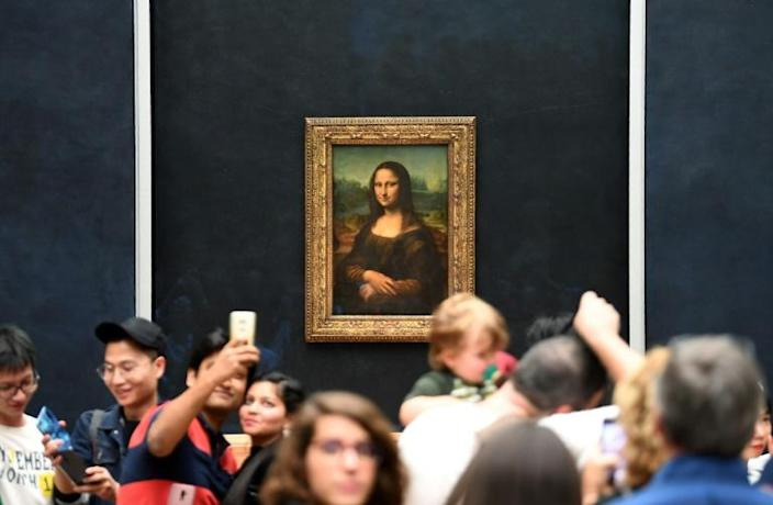 Organisers decided the Mona Lisa should remain in the Louvre's Salle des Etats to help avoid overcrowding. The masterpiece attracts nearly 30,000 people a day (AFP Photo/ERIC FEFERBERG)