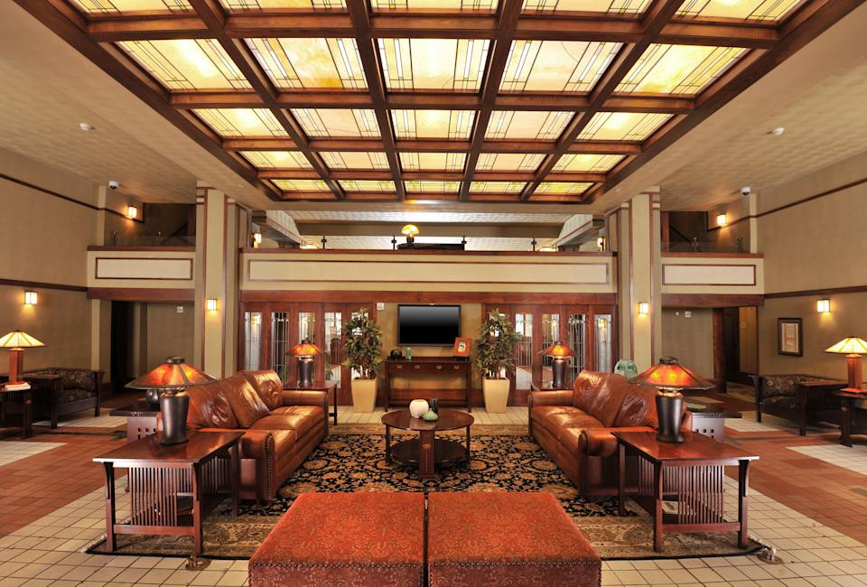 "<p><strong>Best thing to do in Iowa:</strong> Stay in a hotel designed by Frank Lloyd Wright </p> <p>In the heart of Mason City, <a href=""https://www.cntraveler.com/hotels/united-states/mason-city/historic-park-inn-hotel?mbid=synd_yahoo_rss"" rel=""nofollow noopener"" target=""_blank"" data-ylk=""slk:Historic Park Inn"" class=""link rapid-noclick-resp"">Historic Park Inn</a> is the last remaining Frank Lloyd Wright-designed and -built hotel in the world. Listed in the National Registry of Historic Places, the design is pure Prairie School-style—especially the dramatic lobby. The building originally served as both a bank and an inn when it opened in 1910, but competing hotels and financial crises in Mason City caused the Park Inn to decline over the next several decades, and it eventually closed down in 1972. Luckily, some 30 years later, the Frank Lloyd Wright Foundation in Scottsdale, Arizona, certified an extensive renovation of the interior and exterior of the building, which reopened to guests in 2011. We'd say ""historic"" is an understatement.</p>"