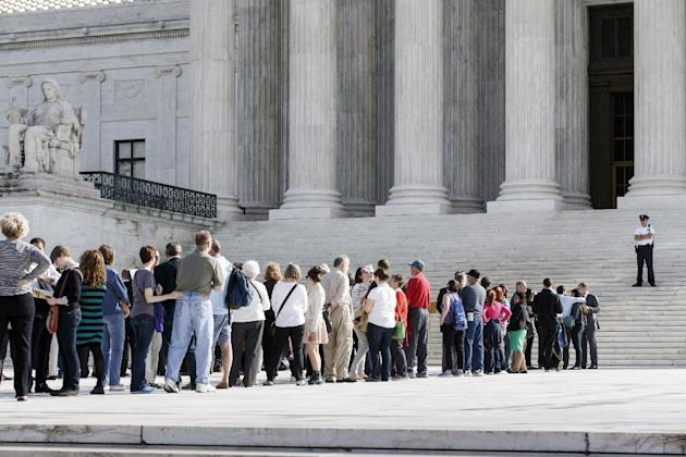 Visitors line up to enter the Supreme Court in Washington. (AP Photo/J. Scott Applewhite, File)