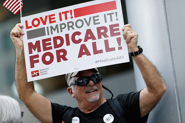 <p>Retired emergency Dr. James Winkler, of Denver, waves a placard during a protest, Friday, June 23, 2017, in downtown Denver, against the Republican health bill that was recently unveiled in the U.S. Senate. (Photo: David Zalubowski/AP) </p>