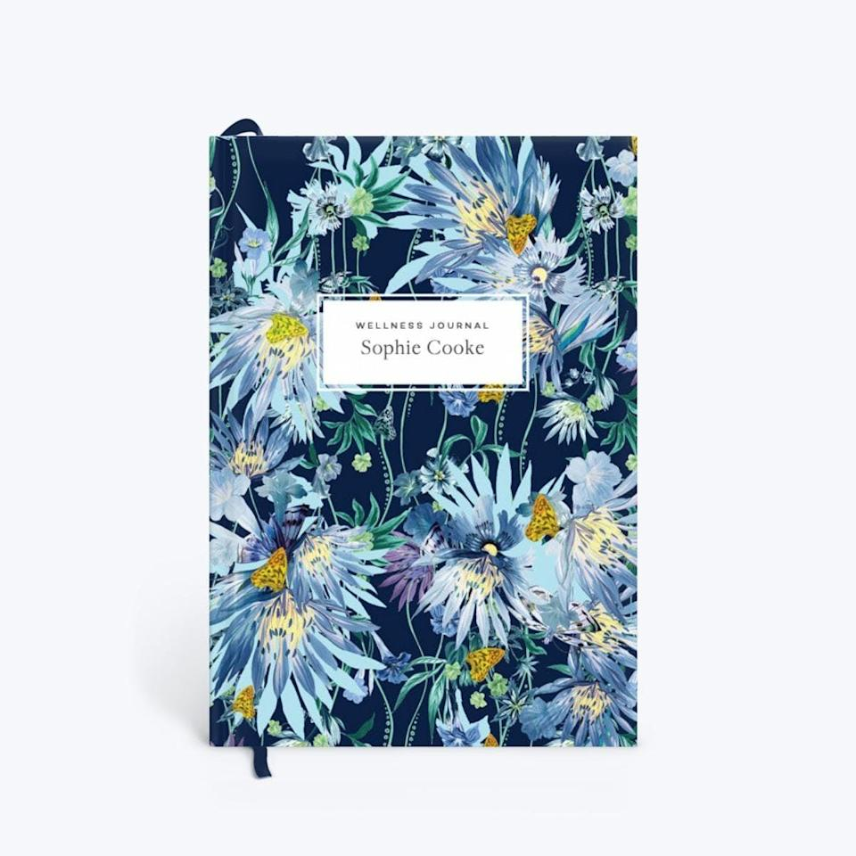 <p>We'd gladly take some notes in this <span>Papier Jungle Bloom Midnight Wellness Journal</span> ($40).</p>