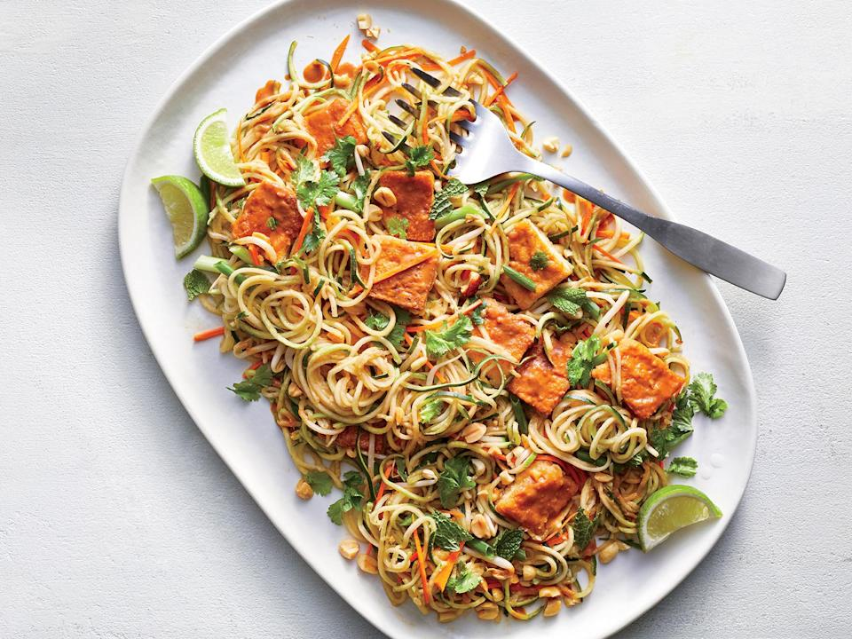 """<p>Pre-cut produce helps this staff favorite come together in a flash. <a href=""""https://www.myrecipes.com/t/vegetables/zucchini"""" rel=""""nofollow noopener"""" target=""""_blank"""" data-ylk=""""slk:Spiralized zucchini"""" class=""""link rapid-noclick-resp"""">Spiralized zucchini</a> and <a href=""""https://www.myrecipes.com/ingredients/vegetable-recipes/summer-squash-recipes"""" rel=""""nofollow noopener"""" target=""""_blank"""" data-ylk=""""slk:summer squash"""" class=""""link rapid-noclick-resp"""">summer squash</a> are in the prepared produce section of many supermarkets; you can also spiralize your own or make ribbons with a vegetable peeler. Squash takes the place of noodles in these bowls, so you'll need a hefty amount for each serving. The zucchini noodles don't require cooking-they'll add freshness and crunch to the finished dish. Make the sauce while the tofu cooks and have the other vegetables at the ready so you can toss and serve immediately.</p>"""