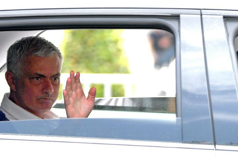 """Mourinho, who says his new club is a project to """"construct,"""" waves from a car after his official presentation as AS Roma coach"""