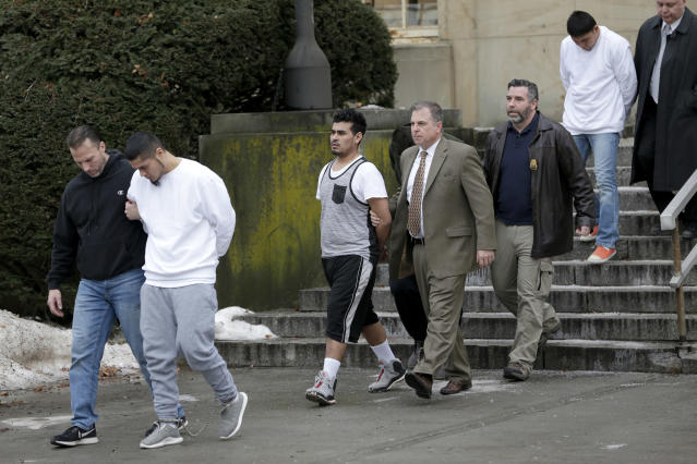 Suspected MS-13 members are escorted to their arraignment in Mineola, N.Y., on Jan. 11, 2018. (Photo: Seth Wenig/AP)