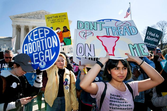 Abortion rights demonstrators including Jaylene Solache, of Dallas, Texas, right, rally outside the Supreme Court in Washington, D.C., on March 4, 2020.